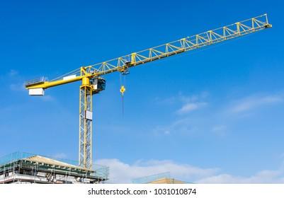 crane on a construction site - blue sky