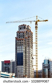 Crane on a construction site. Construction of a skyscraper