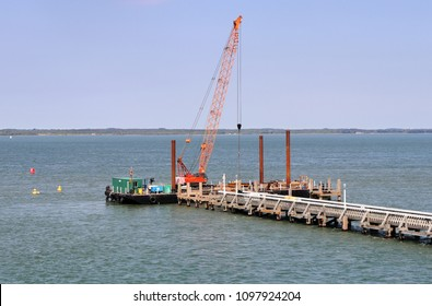 Crane on floating platform constructing a Jetty on the sea