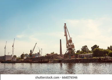Crane on the river Bank in the port, the construction of the embankment on the river
