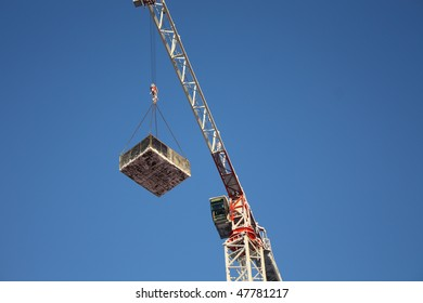 The crane picking up heavy loading and blue sky