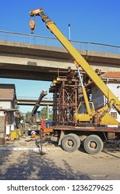Crane and Scaffolding Support at Damaged Bridge Construction Site Repairs
