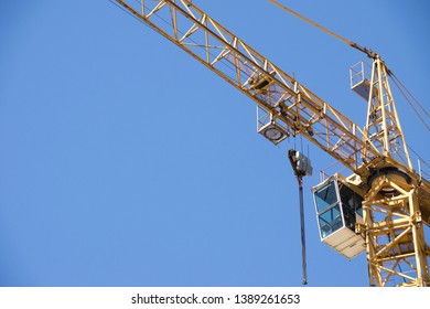 Crane. Self-erection crane over construction site. Crane near bulding. Industrial background. - Image