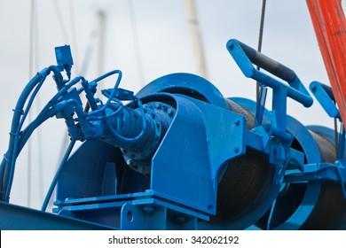 Crane for a ship maintenance detail in a marina. Vertical shot