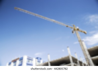 Crane and sky blur to background