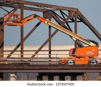 Crane- with a suspended personnel platforms working on a bridge in Minnesota
