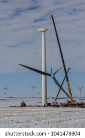 Crane taking the blades of a wind turbine down for repairs.