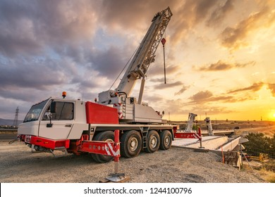 Crane trucks in the construction of a bridge