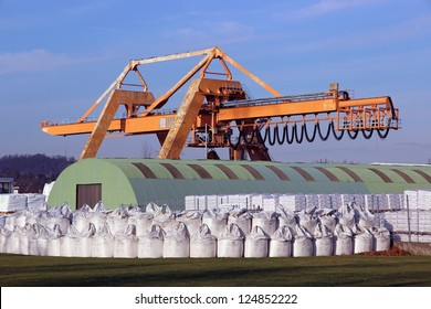 crane with warehouse and bulk bags