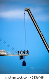 Crane and workers in mid air