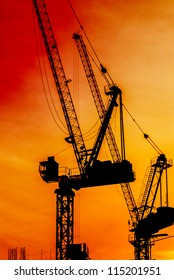 Crane working construction and sunset background