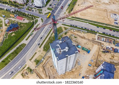 crane working on under construction high-rise building. new residential area. birds eyes view
