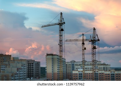crane,construction cranes over building site silhouette with dramatic sky in the evening background,technology transportation material to high site