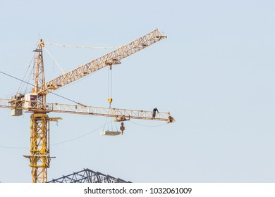 Crane,construction tower cranes equipment over building construction site on white background,technology transportation material for high site.