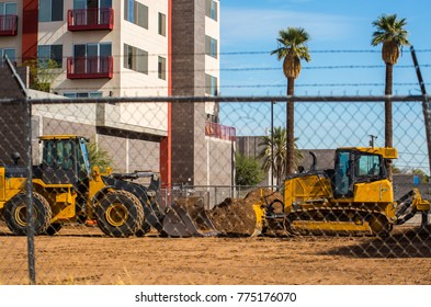 cranes and big yellow trucks and machinery means development and the building of tall structures. A lot of apartments and other high rises are being built in downtown Phoenix, Arizona as ASU campus
