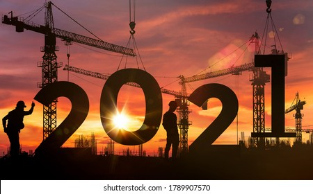 Cranes building construction 2021year sign,Silhouette staff works as a team to prepare to welcome the new year 2021 - Shutterstock ID 1789907570