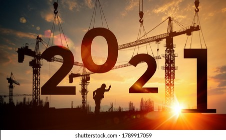 Cranes building construction 2021year sign,Silhouette staff works as a team to prepare to welcome the new year 2021 - Shutterstock ID 1789917059