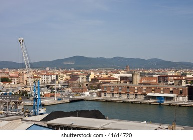 Cranes at a busy shipping port in Italy