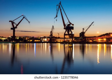 Cranes in Gothenburg at sunset. Gothenburg, Vasstergotland and Bohuslan, Sweden.