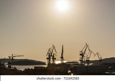 Cranes in harbor of Pula, Croatia in Sunset