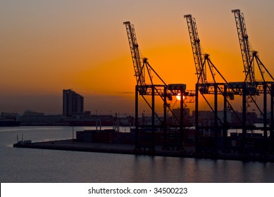 cranes in the harbour at the sunset, Durban South Africa