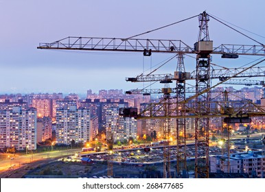 Cranes and housing estate. Kiev, Ukraine. Kyiv, Ukraine