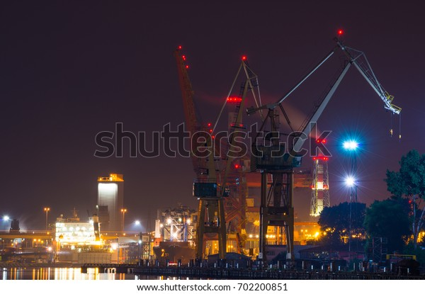 Cranes in the sea port by the night in city of Gdynia- Poland, Europe.
