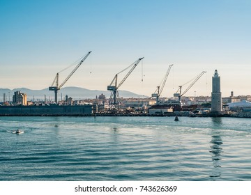 Cranes and shipyards at Livorno harbor. Tuscany, Italy.