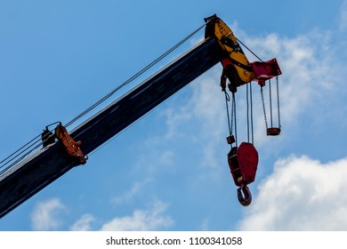 cranes used in construction on blue sky