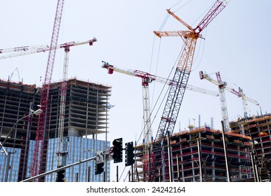 Cranes used in construction of tall buildings.