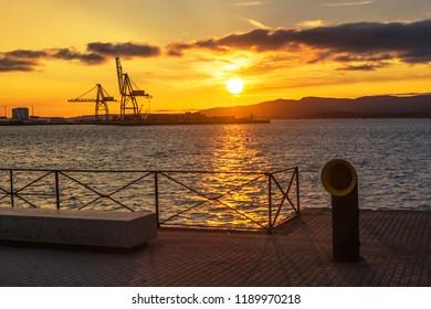 Cranes of Vilagarcia de Arousa commercial harbor at golden sunset