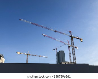 Cranes at work in a construction site in the city