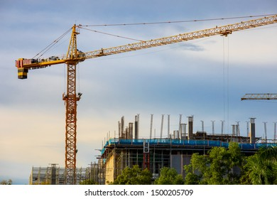 cranes working on a building construction site