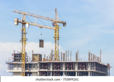 Cranes,construction crane equipment over building construction site on blue sky background on day,technology transportation material to high site,saver equipment for worker.