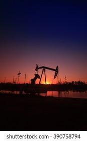 Crank balanced beam pumping unit in the oil field, closeup of photo