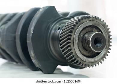 crankshaft of the diesel engine on a white background. flange of fastening of a flywheel to the crankshaft.