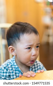 Cranky asian child boy in restaurant.2.5 years old boy crying and sad.Mad kid got upset and sad and he has a negative attitude.Depressed toddler boy complaining.ADHD concept.