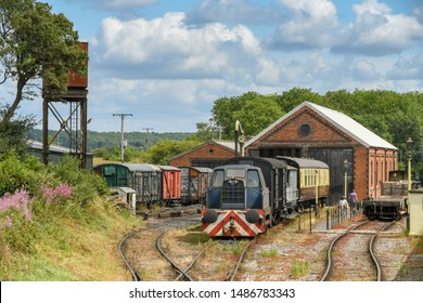 CRANMORE, ENGLAND - JULY 2019: Diesel shunter locomotive and trucks outside the engine sheds at Cramore on the East Somerset steam Railway.