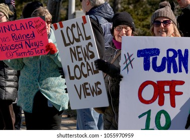 CRANSTON, RHODE ISLAND/ USA-MARCH 19, 2018: Protesters demonstrate the purchase of local NBC 10 station by conservative Sinclair Broadcast Group on March 19, 2018 in Cranston, Rhode Island.