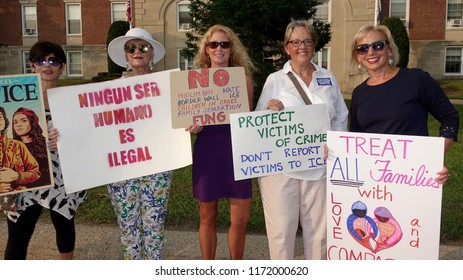 CRANSTON, RHODE ISLAND/USA- AUGUST 27, 2018: Protesters denounce RI Republican gubernatorial candidate Allan Fung for expanding cooperation with ICE