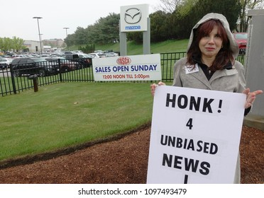 Cranston, Rhode Island/USA- May 12, 2018: RI ReSisters protest TASCA Auto's support of Sinclair Broadcast propaganda Trump TV  on WJAR TV 10  on May 12, 2018 in Cranston, RI