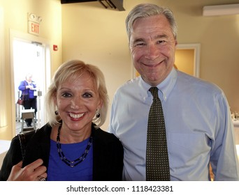 Cranston, Rhode Island/USA-June 8, 2018: United States Senator Sheldon Whitehouse speaks with Dr. Patricia Ricci at his Gaspee Days fundraiser in Cranston, Rhode Island