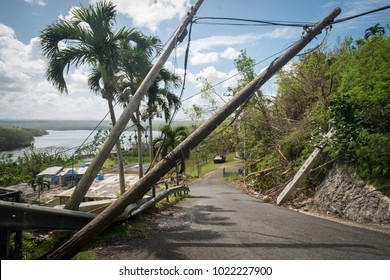 Crash Boat Beach, Puerto Rico / United States: October 25 2017: Broken power lines threaten to fall on drivers on the road down to Crash Boat Beach.