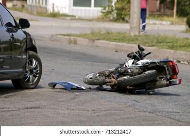 crash moto bike and car on road