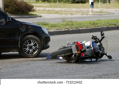 crash moto bike and car on road