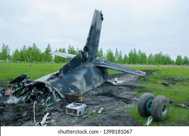 The crash of a transport plane outside the city in the countryside. A charred plane after a crash.