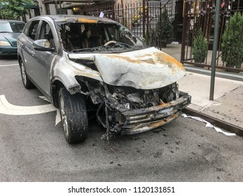Crashed and burnt SUV in the streets of Manhattan.