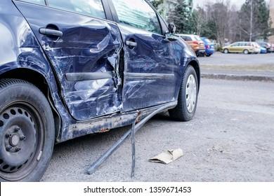 Crashed car after accident, detail on side - metal plates deformed