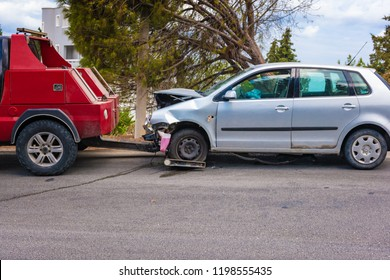 Crashed car after accident ready to be tow away by tow truck