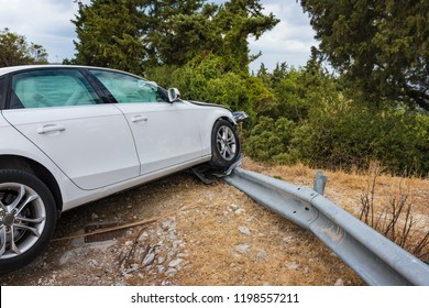 Crashed car with deflated airbags after accident finished on road crashed barrier